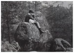 Poulenc with dog on rock