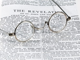 10136286-old-fashioned-round-reading-glasses-laying-on-a-page-from-the-bible-on-the-revelation